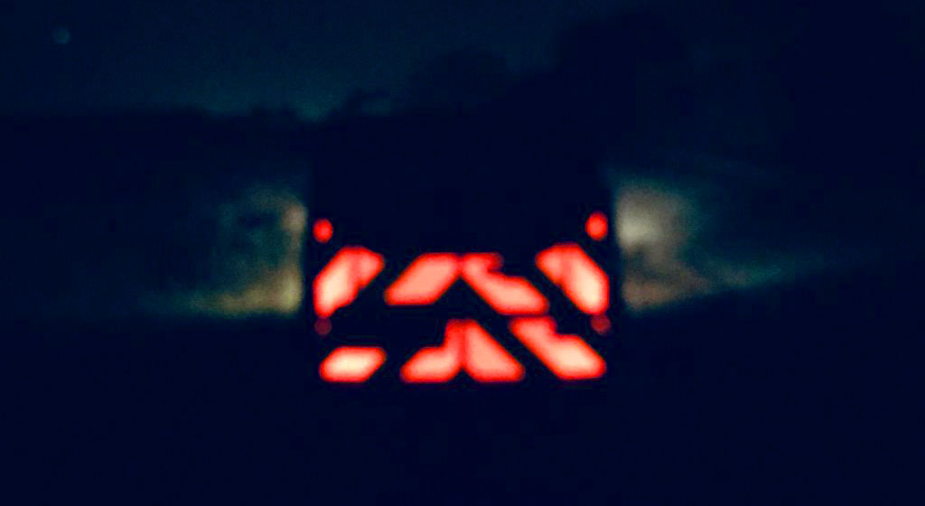 Pic showing a blurred night image of a van with IM red illuminated chevrons fitted